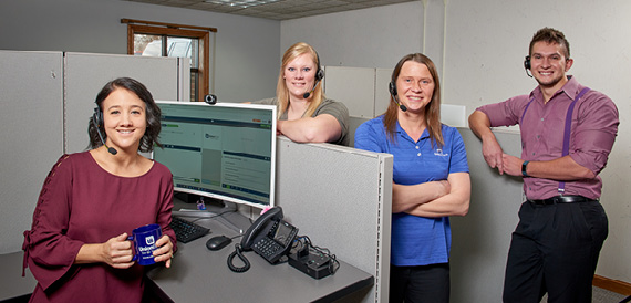 Image Description.  Union Bank Contact Center Representatives pose in Virtual Branch Office.
