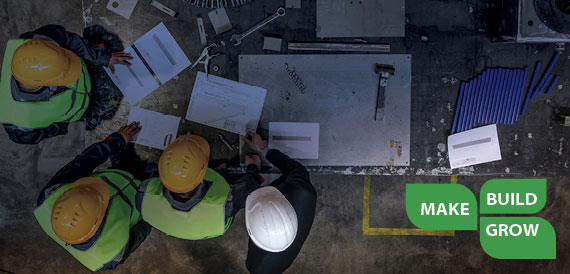Image Description.   Make Build Grow logo banner with construction workers reviewing a floor plan.